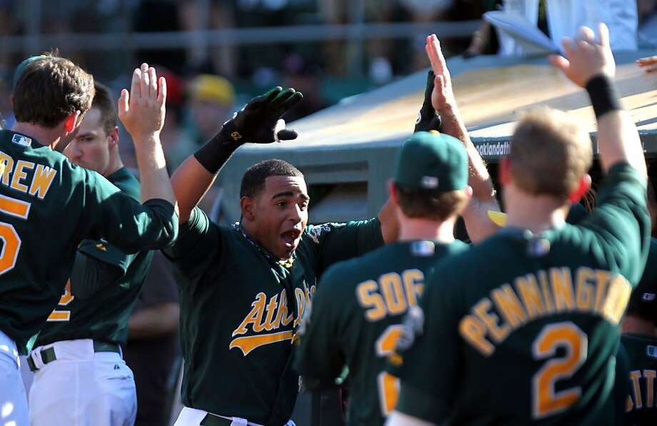 Oakland Athletics Yoenis Cespedes celebrates his go ahead solo home run against the Seattle Mariners in the 8th inning of their MLB baseball game with the Sunday September 30, 2012 in Oakland California Photo: Lance Iversen, The Chronicle