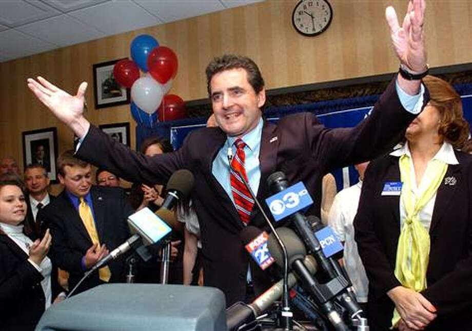 Republican Mike Fitzpatrick celebrates victory in Doylestown, Pa., after defeating Democratic incumbent Patrick Murphy in the race for the state's 8th District. (Art Gentile / Associated Press)