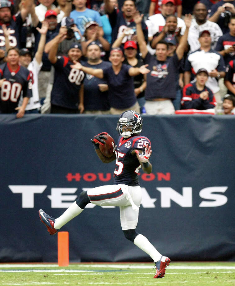 <b><center>Sept. 30: Texans 38, Titans 14</center></b>Texans cornerback Kareem Jackson high steps across the goal line as he returns a fourth quarter  interception for a touchdown during the Texans 38-14 victory over the Titans. Photo: Nick De La Torre, Houston Chronicle / © 2012  Houston Chronicle