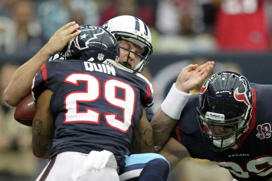 Texans strong safety Glover Quin (29) sacks Titans quarterback Jake Locker during the first quarter.  Locker was injured on the play and left the game. Photo: Nick De La Torre, Houston Chronicle / © 2012  Houston Chronicle