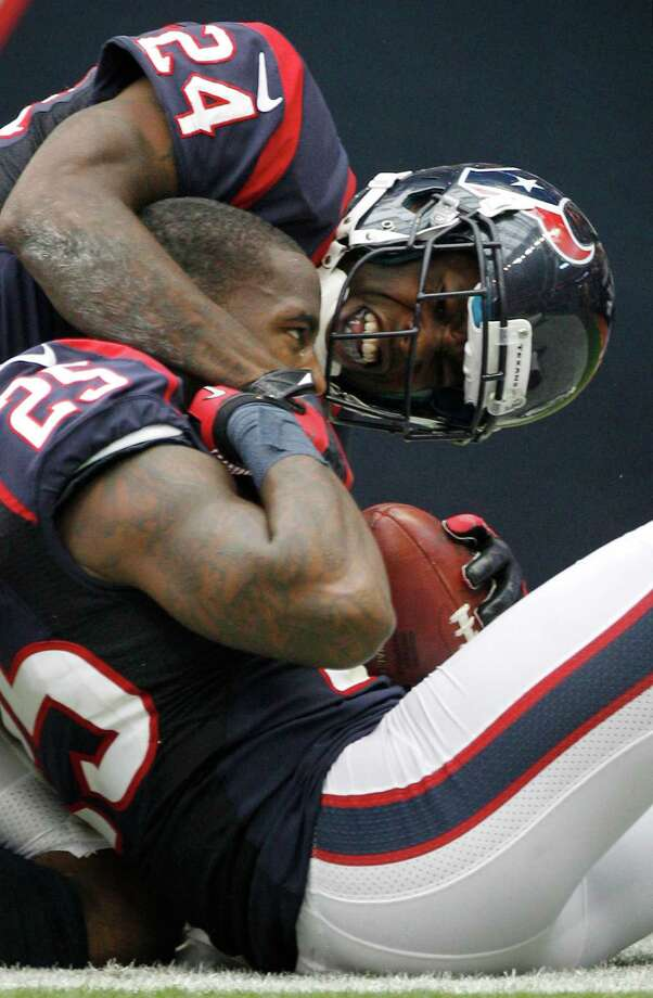 Texans cornerback Johnathan Joseph (24) embraces cornerback Kareem Jackson (25) celebrating Jackson's 63-yard interception return for a touchdown. Photo: Brett Coomer, Houston Chronicle / © 2012  Houston Chronicle