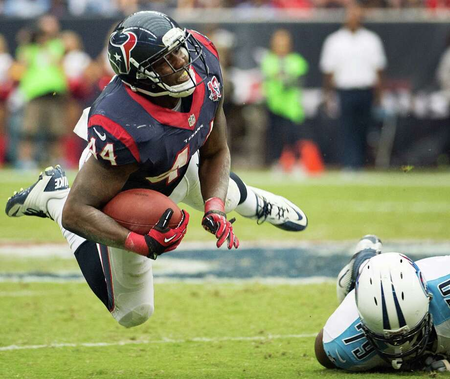 Texans running back Ben Tate is knocked off his feat by Tennessee Titans defensive end Pannel Egboh during the third quarter. Photo: Smiley N. Pool, Houston Chronicle / © 2012  Houston Chronicle