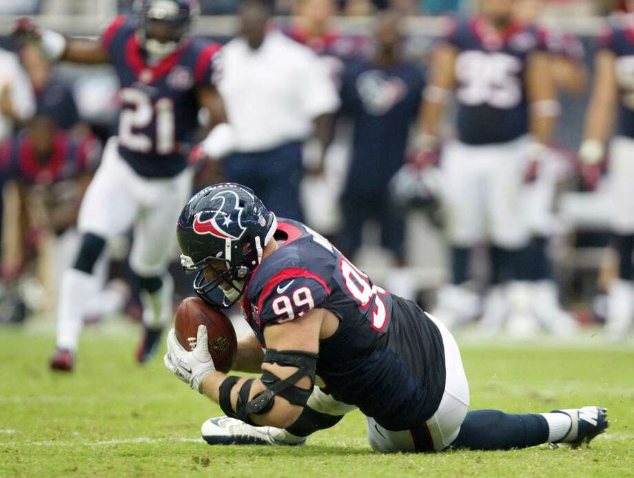 Texans defensive end J.J. Watt dives on a fumble by Tennessee = quarterback Matt Hasselbeck during the fourth quarter. Photo: Brett Coomer, Houston Chronicle / © 2012  Houston Chronicle