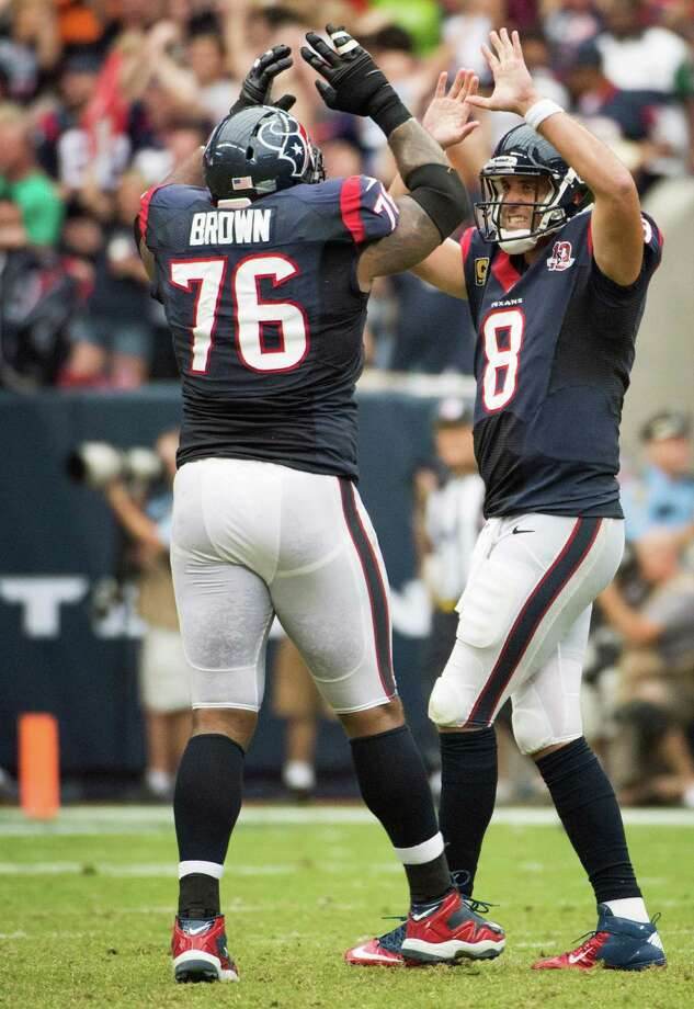 Texans quarterback Matt Schaub (8) celebrates with tackle Duane Brown (76) after throwing a 28-yard touchdown pass to Owen Daniels. Photo: Smiley N. Pool, Houston Chronicle / © 2012  Houston Chronicle