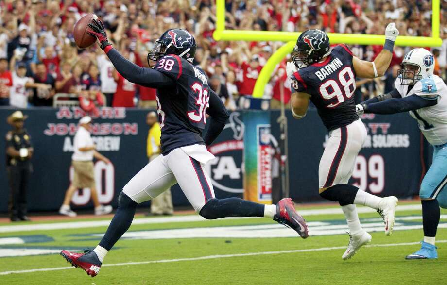 Texans free safety Danieal Manning (38) raises the football as he runs into the end zone on a 55-yard interception return for a touchdown against the Titans . Photo: Brett Coomer, Houston Chronicle / © 2012  Houston Chronicle