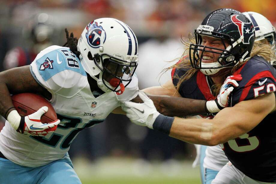 Texans linebacker Brooks Reed (58) brings down Titans running back Chris Johnson (28) during the second quarter. Photo: Brett Coomer, Houston Chronicle / © 2012  Houston Chronicle