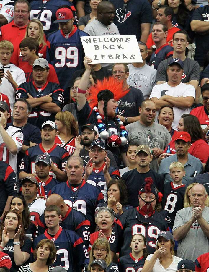 A fan holds a sign welcoming back the regular NFL referees. Photo: Karen Warren, Houston Chronicle / © 2012  Houston Chronicle