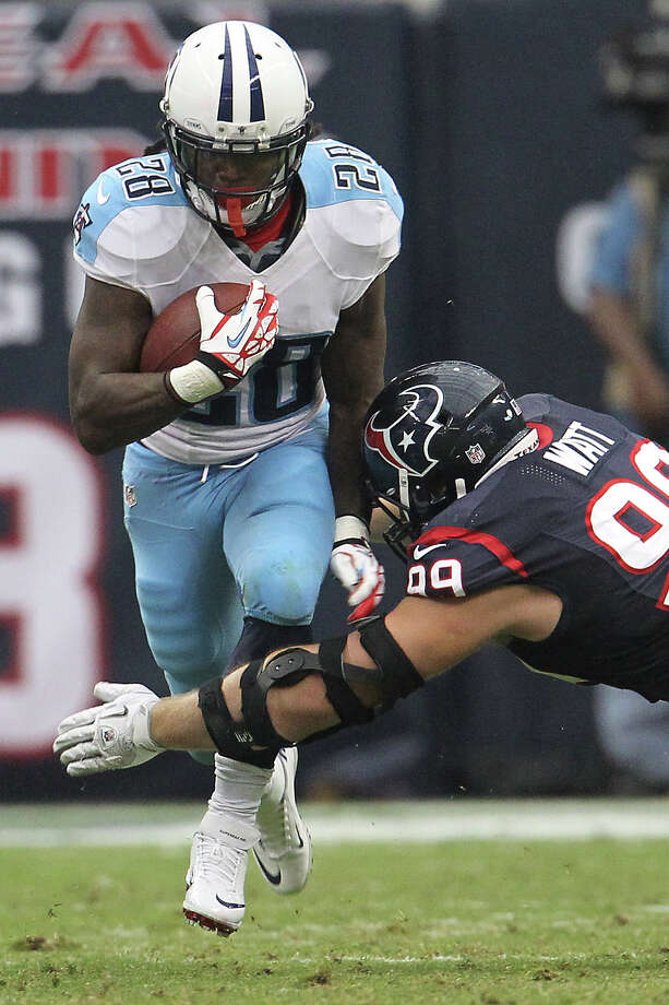 Titans running back Chris Johnson (28) tries to get past Texans defensive end J.J. Watt (99). Photo: Karen Warren, Houston Chronicle / © 2012  Houston Chronicle