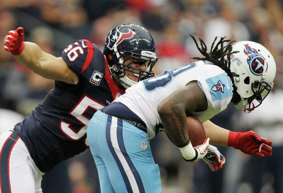 Texans inside linebacker Brian Cushing (56) wraps up Titans running back Chris Johnson (28) during the second quarter. Photo: Brett Coomer, Houston Chronicle / © 2012  Houston Chronicle