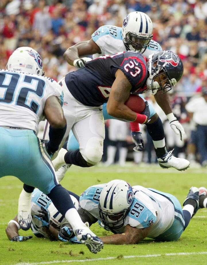 Houston Texans running back Arian Foster (23) pushes toward the end zone on a scoring drive during the first quarter. Photo: Brett Coomer, Houston Chronicle / © 2012  Houston Chronicle