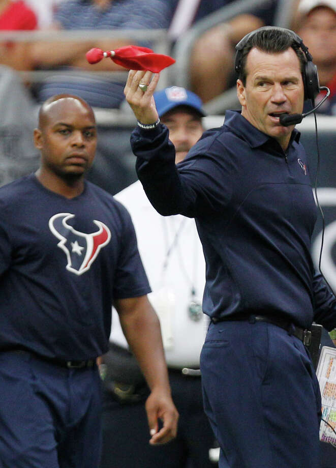 Texans head coach Gary Kubiak throws a challenge flag during the first quarter. Photo: Brett Coomer, Houston Chronicle / © 2012  Houston Chronicle