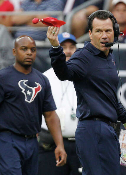 Texans head coach Gary Kubiak throws a challenge flag during the first quarter.