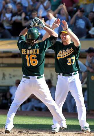 Oakland Athletics Josh Reddick celebrates his two run home run in the 8th inning with Brandon Moss during their MLB baseball game with the Seattle Mariners Sunday September 30, 2012 in Oakland California. A's win 5-2 Photo: Lance Iversen, The Chronicle