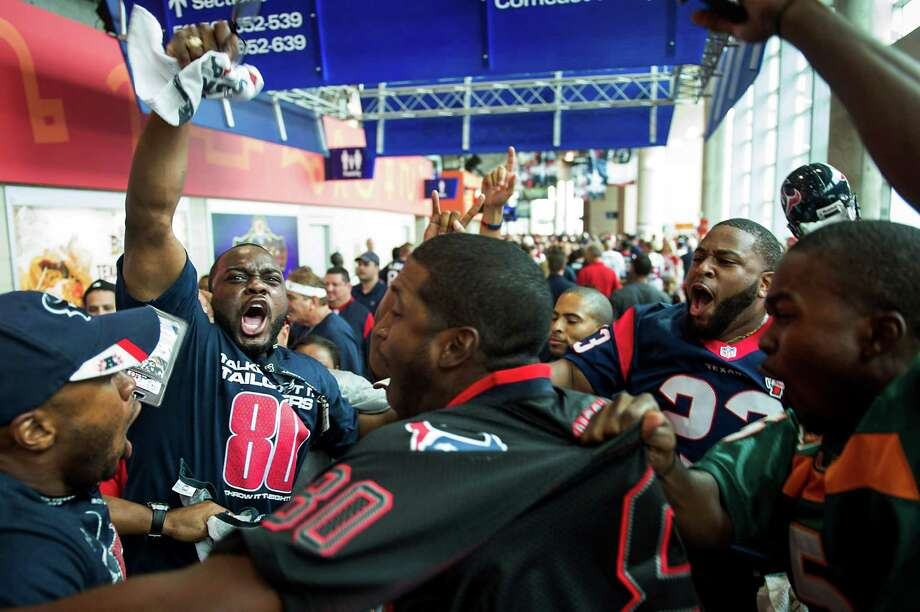 Texans fans get pumped up on the upper concourse before their team faces the Tennessee Titans at Reliant Stadium. Photo: Smiley N. Pool, Houston Chronicle / © 2012  Houston Chronicle