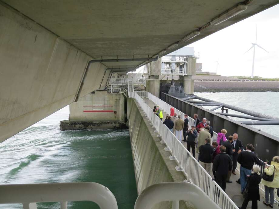 On the catwalk of the Scheldt Storm Surge Barrier in the Netherlands, which protects the Dutch coastline, are members of a Galveston fact-finding delegation.