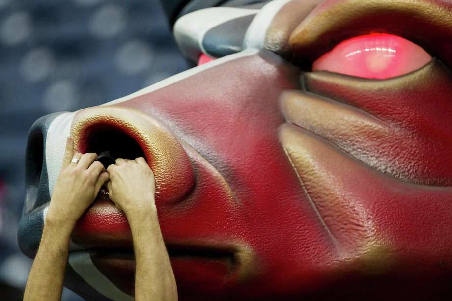 The smoke pipe in the nose of the Houston Texans bull is adjusted before the Texans game against the Tennessee Titans. Photo: Brett Coomer, Houston Chronicle / © 2012  Houston Chronicle