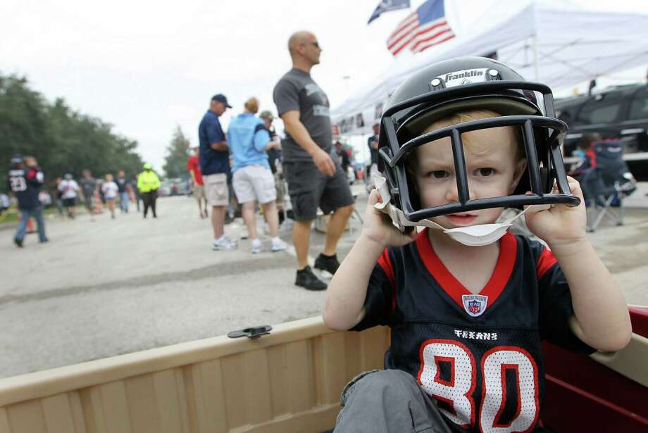 Jacobi Stegman, 2, who is named after former Texans receiver  Jacobi Jones, puts on his game face on while tailgating in the blue lot. Photo: Karen Warren, Houston Chronicle / © 2012  Houston Chronicle