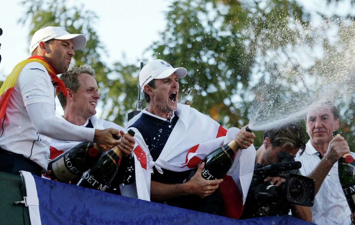 Europe's Sergio Garcia, left to right, Luke Donald and Justin Rose celebrate after winning the Ryder Cup PGA golf tournament Sunday, Sept. 30, 2012, at the Medinah Country Club in Medinah, Ill. (AP Photo/Chris Carlson)