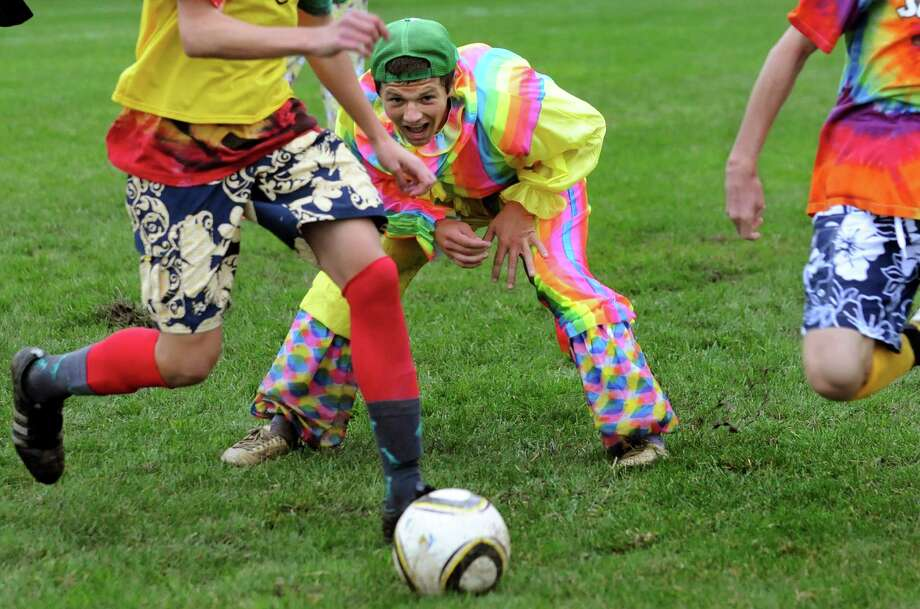 Niskayuna varsity captain Phil Weeber, center, dresses in a clown suit during a Funky Friday soccer practice on Friday, Sept. 28, 2012, at Niskayuna High in Niskayuna, N.Y. (Cindy Schultz / Times Union) Photo: Cindy Schultz / 00019420A