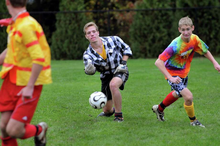 Niskayuna goalkeeper Taylor Tear, center, throws out the ball during a Funky Friday soccer practice on Friday, Sept. 28, 2012, at Niskayuna High in Niskayuna, N.Y. Joining him are teammates Colby Vickerson, left, and Bobby Chapman. (Cindy Schultz / Times Union) Photo: Cindy Schultz / 00019420A