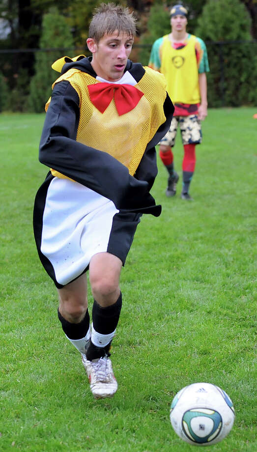Niskayuna's Nicker Petraccione, left, dresses in a penguin suit during a Funky Friday soccer practice on Friday, Sept. 28, 2012, at Niskayuna High in Niskayuna, N.Y. (Cindy Schultz / Times Union) Photo: Cindy Schultz