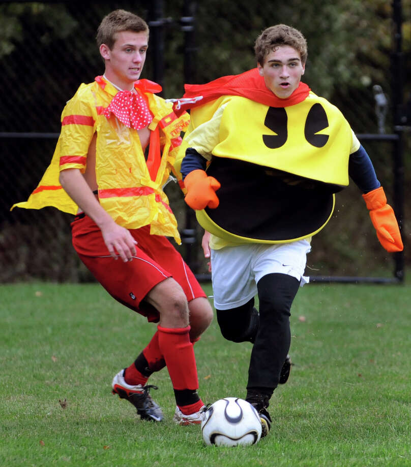 Niskayuna's Christian Koudal, wearing a Pac Man costume, right, controls the ball as teammate Colby Vickerson defends during a Funky Friday soccer practice on Friday, Sept. 28, 2012, at Niskayuna High in Niskayuna, N.Y. (Cindy Schultz / Times Union) Photo: Cindy Schultz / 00019420A