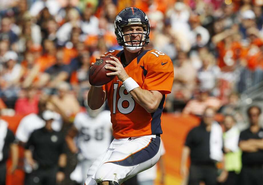 Broncos quarterback Peyton Manning answered his doubters by passing for 338 yards and three touchdowns. Photo: David Zalubowski, Associated Press