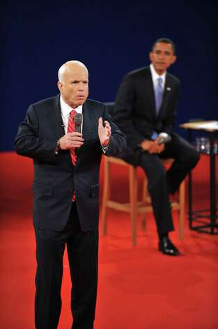 Republican John McCain makes a point as Democrat Barack Obama (R) listens during their second presidential debate at Belmont University's Curb Rvent Center on October 7, 2008 in Nashville, Tennessee.  AFP PHOTO JIM WATSON (Photo credit should read JIM WATSON/AFP/Getty Images) Photo: JIM WATSON / AFP