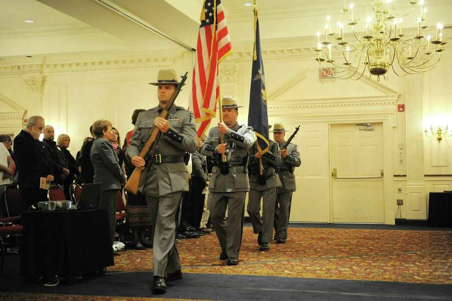 Members of the New York State Police Troop G Honor Guard post the colors at the start of Reflections of Love, Donor Memorial Service at the  Desmond Hotel on Sunday, Sept. 30, 2012 in Colonie, NY.  The service was put on by the Sight Society of Northeastern New York and the Lion's Bank at Albany and was held to pay tribute to those who have given the gift of life and sight through organ donation.   (Paul Buckowski / Times Union) Photo: Paul Buckowski