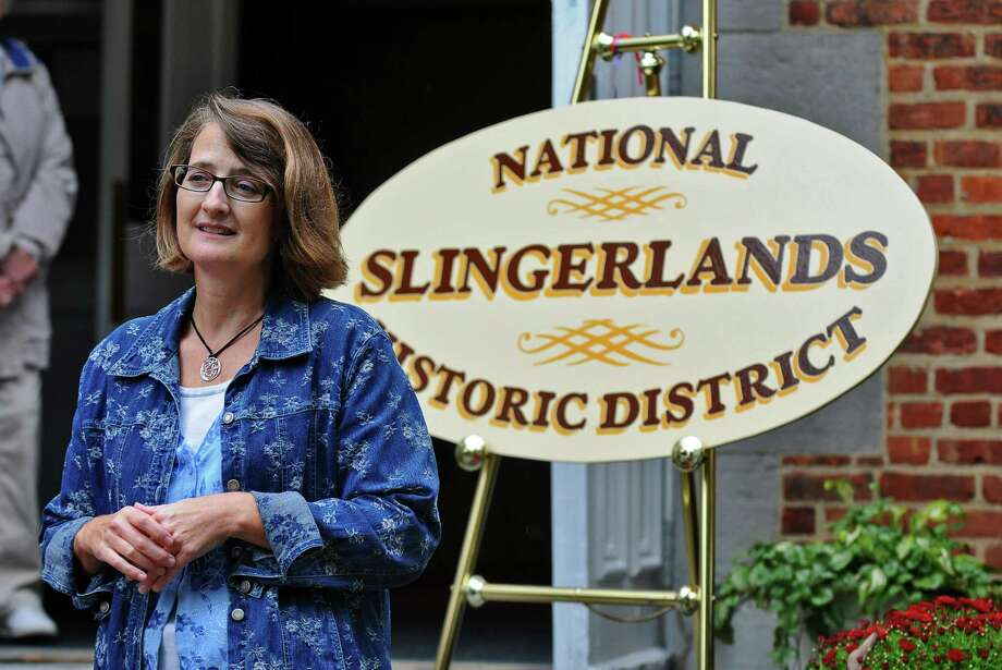 Bethlehem Town Historian Susan Leath speaks about the new Slingerlands Historic District, which has been listed on the State and National Registers of Historic Places, during a ceremony at the Community United Methodist Church on Sunday Sept. 30, 2012 in Slingerlands, NY.  The signs will be installed soon on New Scotland Avenue. (Philip Kamrass / Times Union) Photo: Philip Kamrass / 00019295A