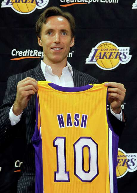 With the additions of guard Steve Nash (above) and center Dwight Howard, the Lakers stole some of the thunder their roommate Clippers were gathering in Los Angeles. Photo: Reed Saxon / AP