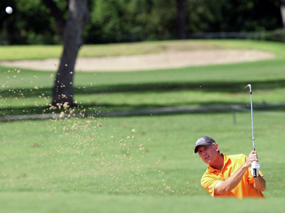 Craig Hall works hits out of a sand trap during the final round of the Greater San Antonio Senior Men's Championship at Brackenridge Park, Sunday, Sept. 30, 2012. Two rounds were played on Sunday after Saturday's round was postponed due to the weather. Photo: JERRY LARA, Express-News / © 2012 San Antonio Express-News