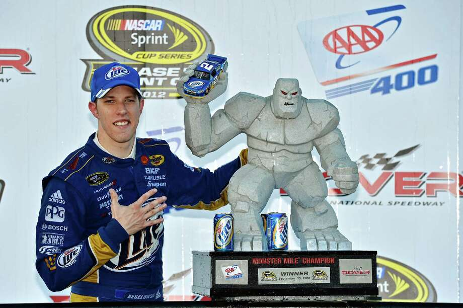 Brad Keselowski poses with the trophy after winning the NASCAR Sprint Cup Series auto race at Dover International Speedway, Sunday, Sept. 30, 2012, in Dover, Del. (AP Photo/Autostock, Brian Czobat) MANDATORY CREDIT Photo: Brian Czobat / KINRN