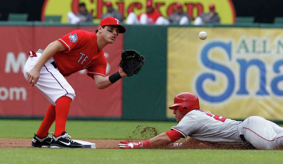 The Angels' Mike Trout becomes the first rookie with 40 stolen bases and 30 homers, but his good work likely won't result in a playoff berth after a split of a doubleheader with the Rangers. Photo: LM Otero / AP