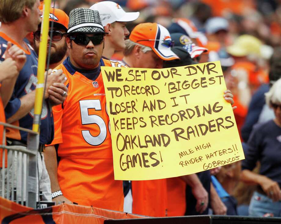 Even though Denver rolled over Oakland 37-6, this Broncos fans might be overstating things a bit since Sunday's victory was just the Broncos' first over the Raiders at home since 2007. Photo: David Zalubowski / AP