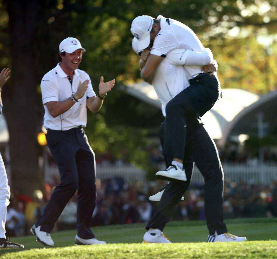 The European celebration begins after Martin Kaymer, top, won to clinch the retention of the Cup. Photo: Scott Strazzante / Chicago Tribune