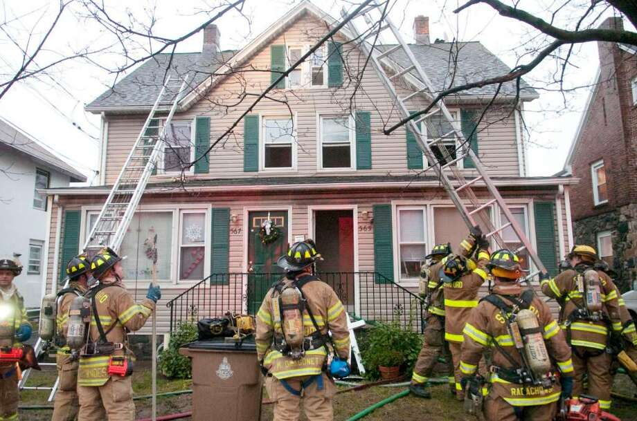 Stamford firefighters at the scene of a two-alarm fire at 565 Hope St. in Stamford, Conn. on Wednesday, Dec. 9, 2009. Photo: Chris Preovolos / Stamford Advocate