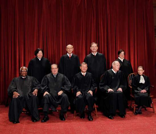 FILE - This Oct. 8, 2010 file photo shows the justices of the U.S. Supreme Court in a group portrait at the Supreme Court Building in Washington. The Supreme Court is embarking on a new term beginning Monday, Oct. 1, 2012, that could be as consequential as the last one with the prospect for major rulings about affirmative action, gay marriage and voting rights. Seated from left to right are: Associate Justice Clarence Thomas, Associate Justice Antonin Scalia, Chief Justice John G. Roberts, Associate Justice Anthony M. Kennedy, Associate Justice Ruth Bader Ginsburg. Standing, from left are: Associate Justice Sonia Sotomayor, Associate Justice Stephen Breyer, Associate Justice Samuel Alito Jr., and Associate Justice Elena Kagan. (AP Photo/Pablo Martinez Monsivais) Photo: Pablo Martinez Monsivais
