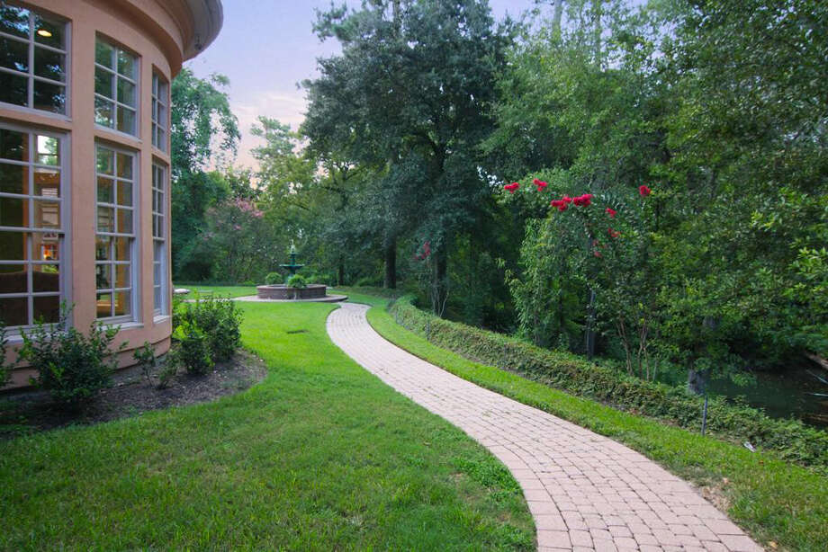 The brick-paved walkway in the outer grounds provides a smooth walking trail. Photo: Daniel Zimmerman Real Estate Agency