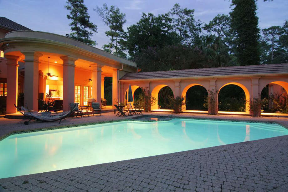 The in-ground pool is heated and has an attached hot tub. Photo: Daniel Zimmerman Real Estate Agency