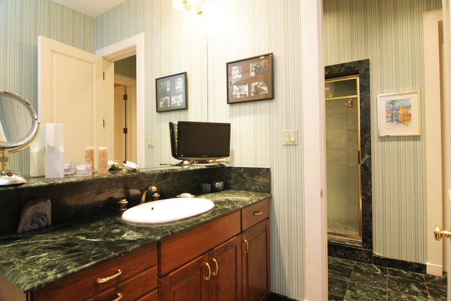 This additional bathroom in the home has tile, a large vanity and shower stall. Photo: Daniel Zimmerman Real Estate Agency