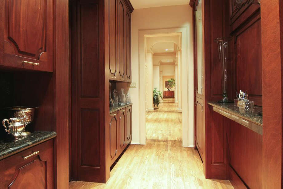 The butler's pantry offers additional storage. Photo: Daniel Zimmerman Real Estate Agency