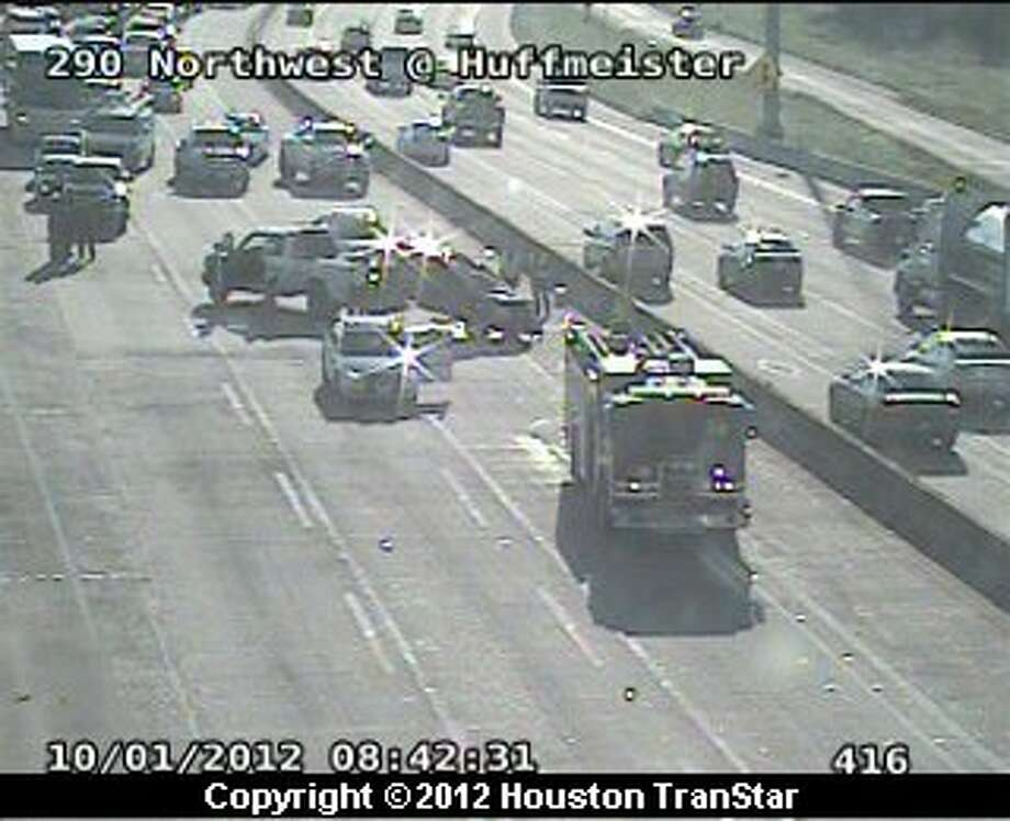 Traffic was snarled on U.S. 290 near Huffmeister after an SUV flipped over Monday morning. Photo: Houston Transtar