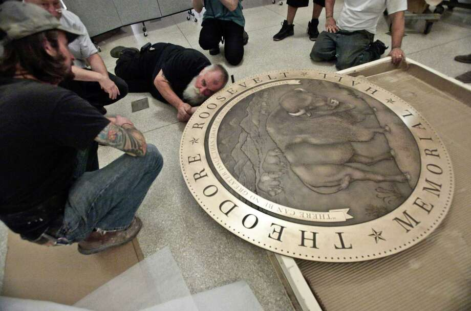 In this Thursday, Sept. 27, 2012 photo, workers prepare a floor medallion for the Theodore Roosevelt Memorial at the American Museum of Natural History in New York. The AMNH is reopening the two-story Theodore Roosevelt Memorial after a three-year, $42.1 million restoration project. Photo: Bebeto Matthews, AP / AP
