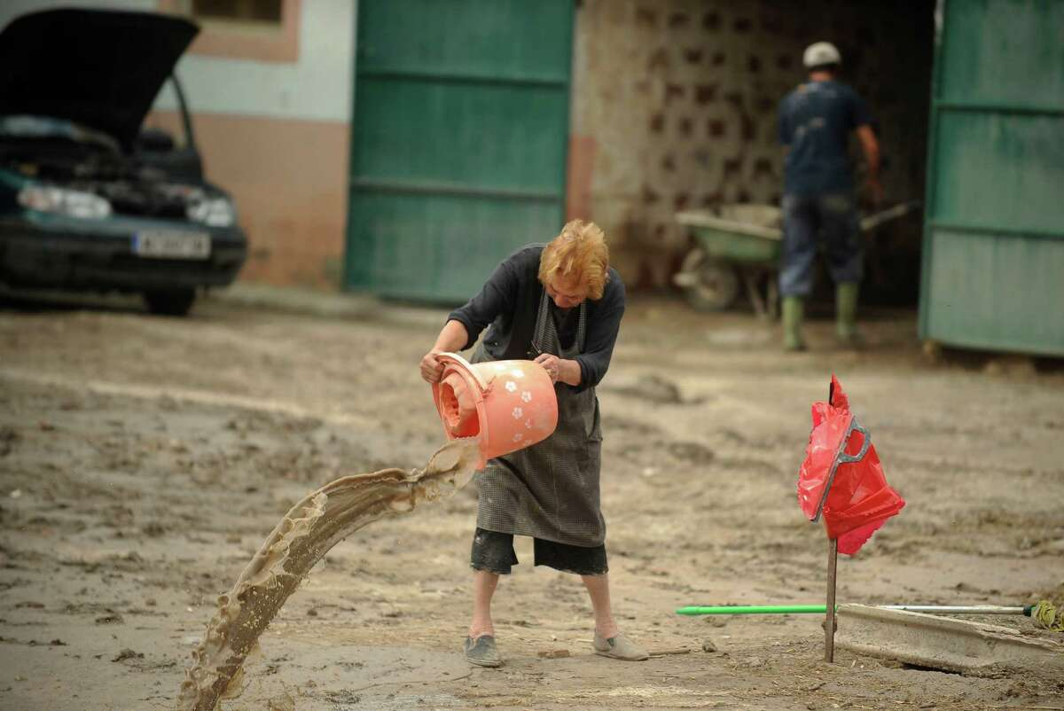 Beatriz, a resident of the southern city of Lorca, cleans a flooded street of Lorca, near Murcia, southeastern Spain, on September 30, 2012. Ten people in total have died in Spain in the regions of Andalusia and Murcia due to flash flooding brought on by downpours. The heavy rains have also damaged homes, caused the collapse of two bridges and forced roads to close. AFP PHOTO/Pedro ARMESTREPEDRO ARMESTRE/AFP/GettyImages