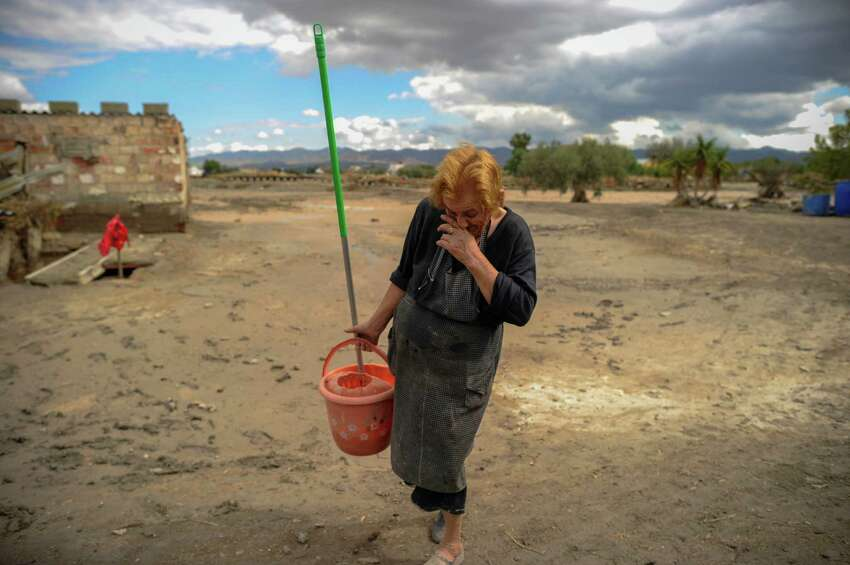Beatriz, a resident of the southern city of Lorca, cries while cleaning a flooded area in Lorca, near Murcia, southeastern Spain, on September 30, 2012. Ten people in total have died in Spain in the regions of Andalusia and Murcia due to flash flooding brought on by downpours. The heavy rains have also damaged homes, caused the collapse of two bridges and forced roads to close. AFP PHOTO/Pedro ARMESTREPEDRO ARMESTRE/AFP/GettyImages