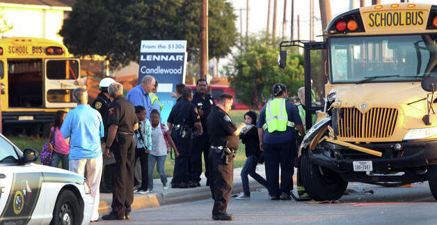 Students leave a school bus after a San Antonio Independent School bus and a Judson Independent School District School bus collided on Foster road in front of Karen Wagner High School about 7:30 a.m. Monday October 1, 2012. Photo: John Davenport/Express-News