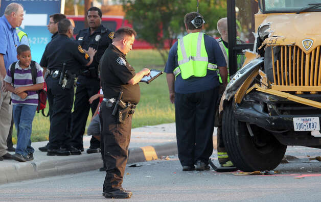 Students leave a school bus after a San Antonio Independent School bus and a Judson Independent School District School bus collided on Foster road in front of Karen Wagner High School about 7:30 a.m. Monday October 1, 2012. Photo: JOHN DAVENPORT, John Davenport/Express-News / SAN ANTONIO EXPRESS-NEWS (Photo can be sold to the public)