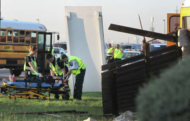 Paramedics prepare to transport a student after a San Antonio Independent School bus and a Judson Independent School District School bus collided on Foster road in front of Karen Wagner High School about 7:30 a.m. Monday October 1, 2012. Photo: John Davenport/Express-News