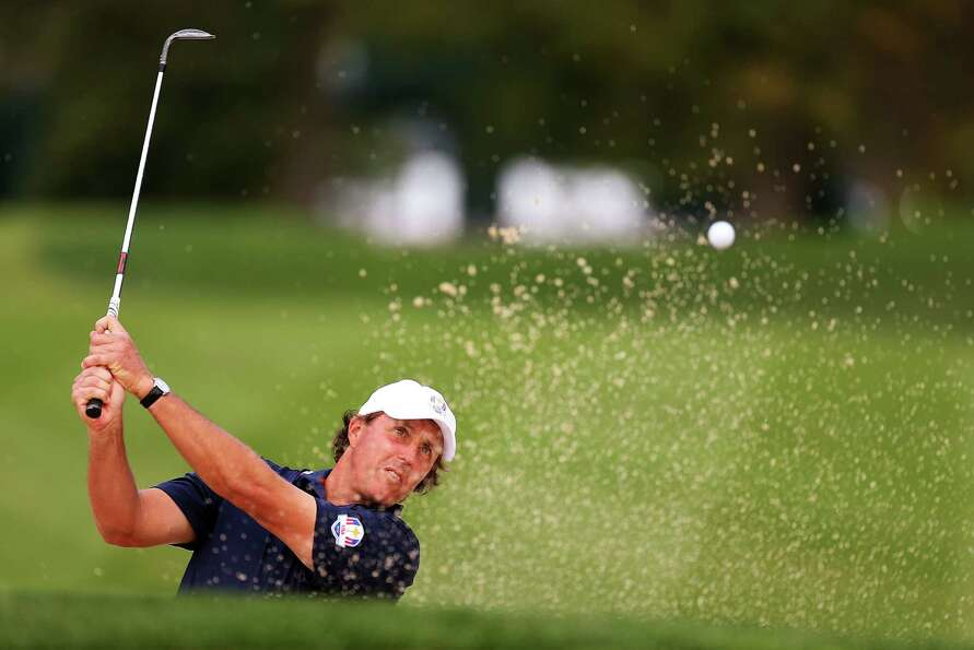 MEDINAH, IL - SEPTEMBER 26:  Phil Mickelson of the USA plays a bunker shot during the third preview